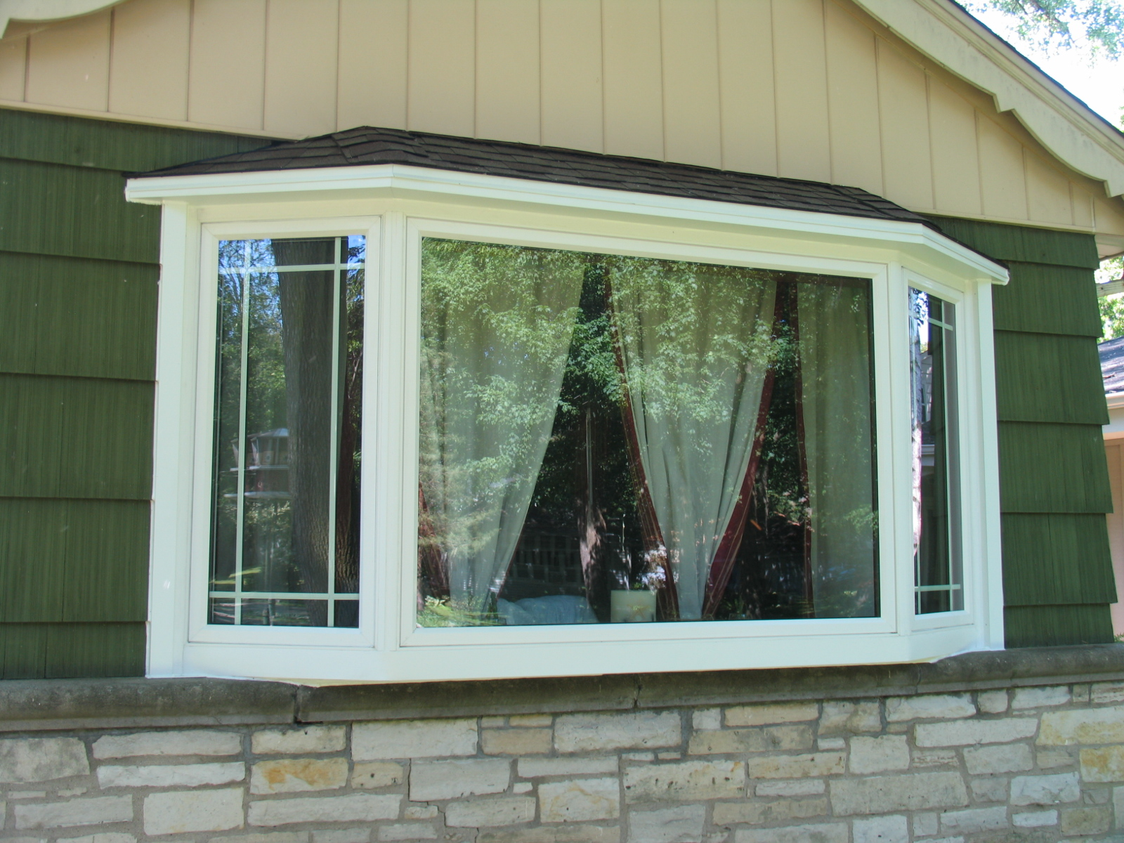 All about windows siding inc by abby windows for Discount bay windows
