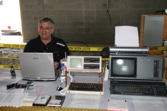 Mike shows world's 1st Laptop