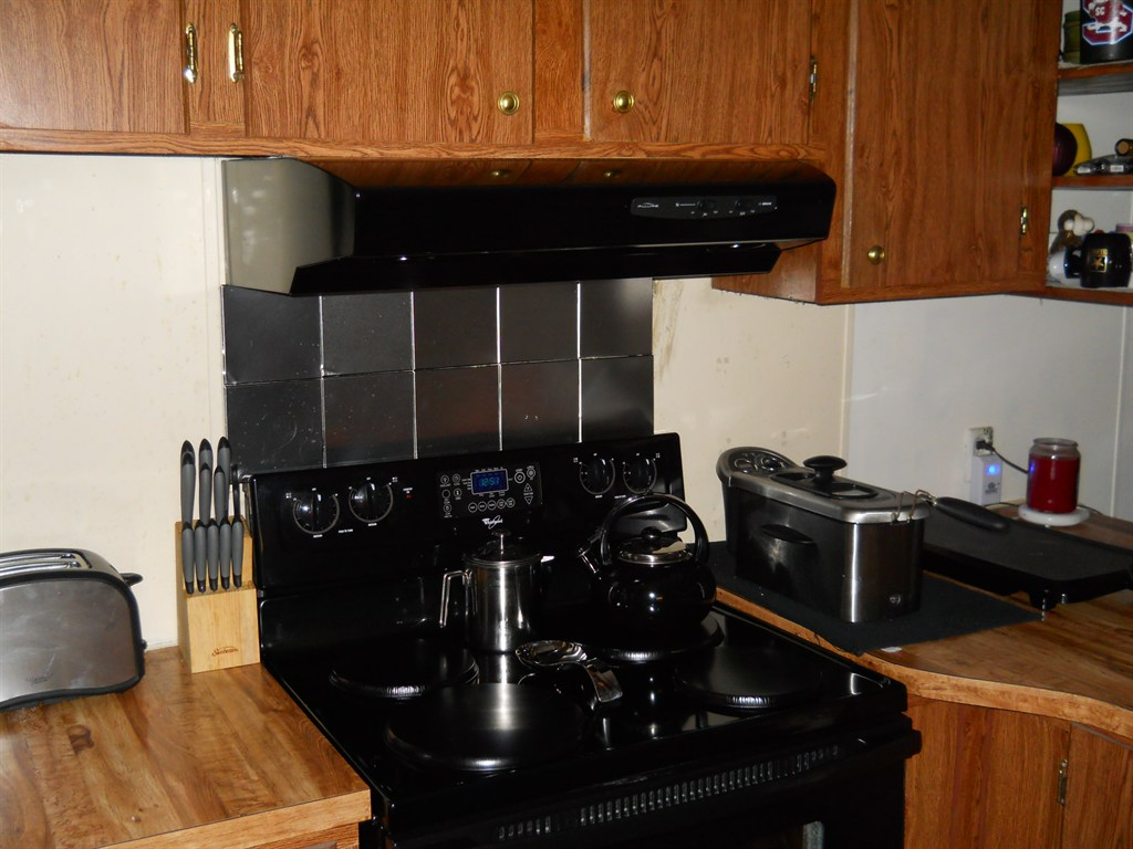 Install new Backsplash wall with new Black Decorative range hood