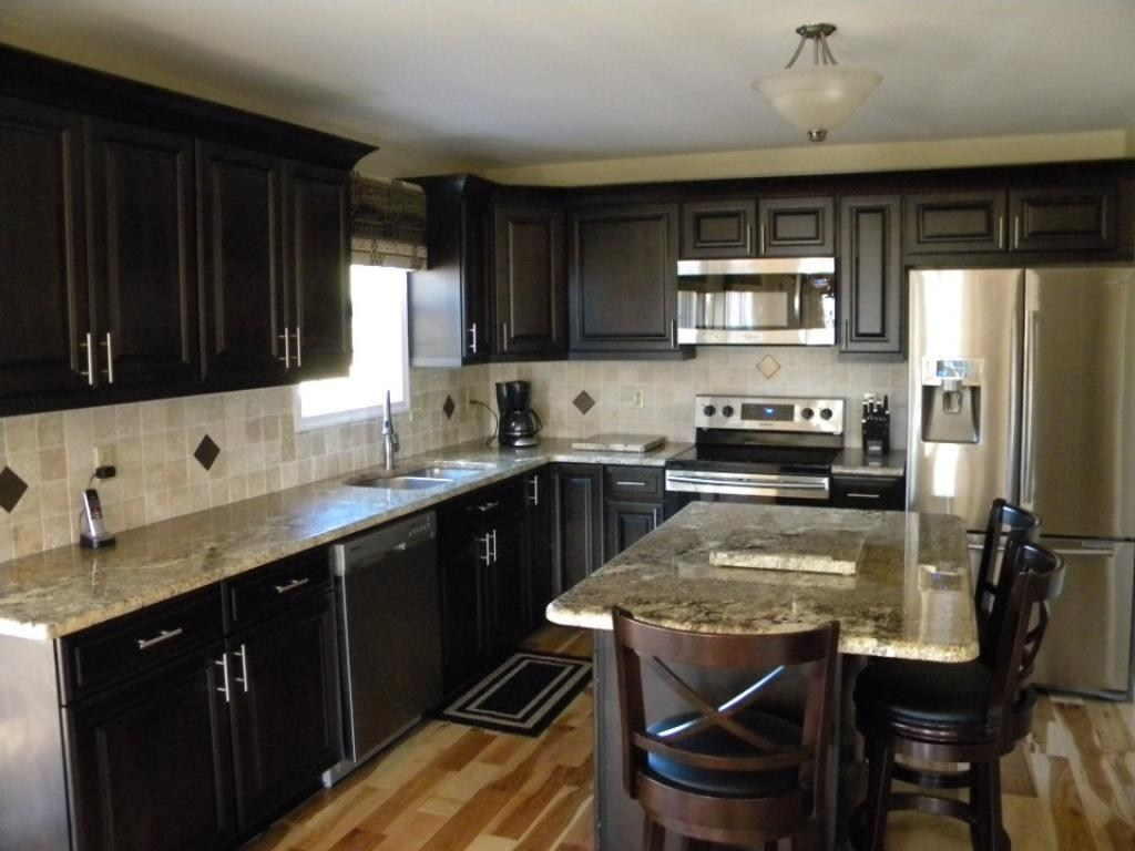 Cabinet lights, Light granite countertops and Dark cabinets on