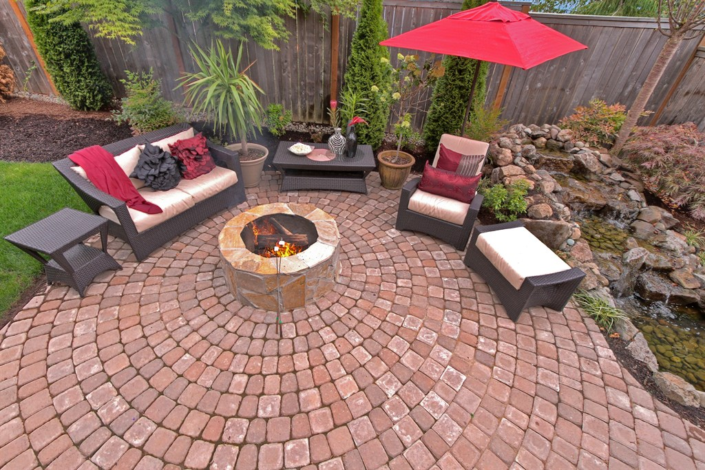 PAVER PATIO, FIRE PIT, RAISED ROCK WATER FEATURE