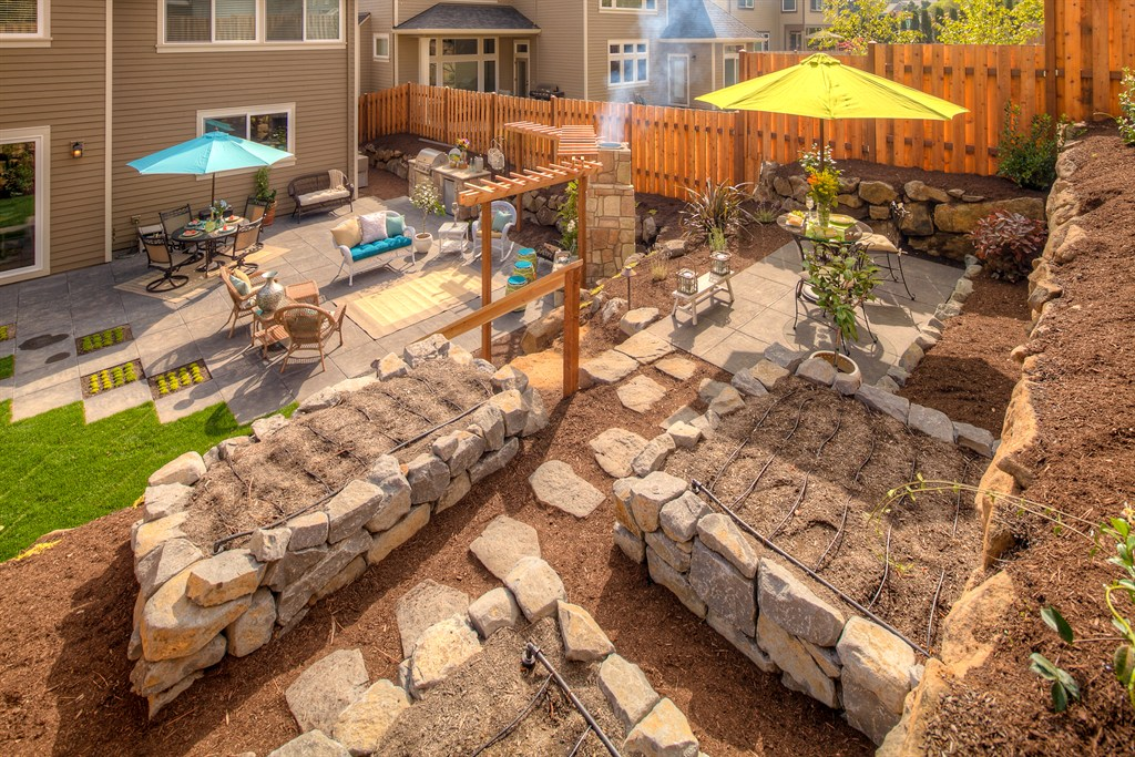 FAMILY LIVING - GRILL/COUNTER, PAVER PATIO, FIRE PLACE, BUBBLER, STEPABLE GROUND COVER, PLAY AREA, RAISED GARDEN BEADS, BISTRO AREA FOR WATCHING KIDS PLAY