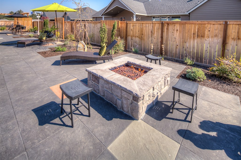 BEAUTIFUL STRETCH OF PROPERTY W/FIRE PIT, PAVERS, PRIVACY SCREENS, WATER FEATURE, PERGOLA -