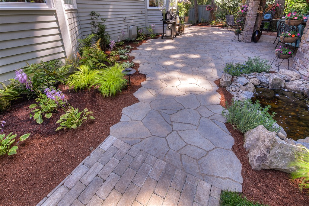 FLAGSTONE PATIO TRANSITIONS INTO STONE PAVER WALKWAY