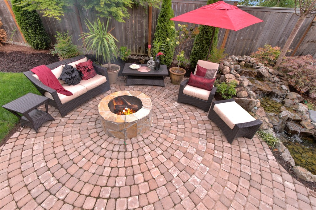 PAVER PATIO, FIRE PIT, RAISED ROCK WATER FEATURE/POND