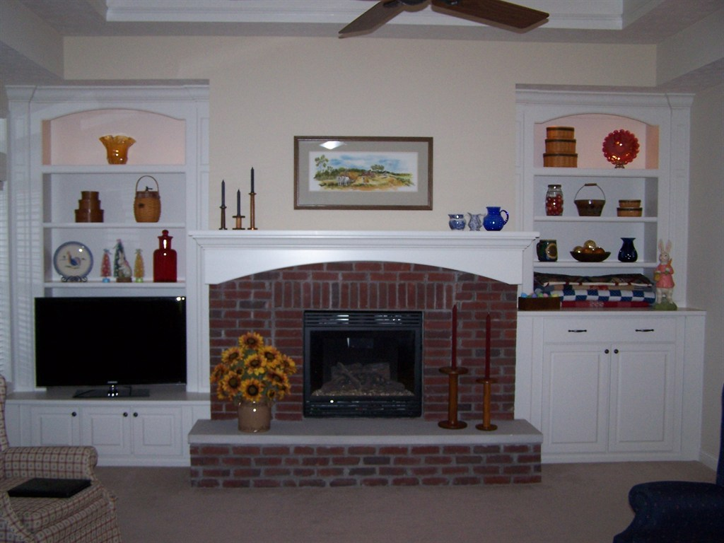 Fireplace mantel and bookcases