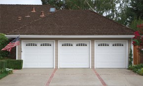 $374 for a Complete Garage Door Rehab and...