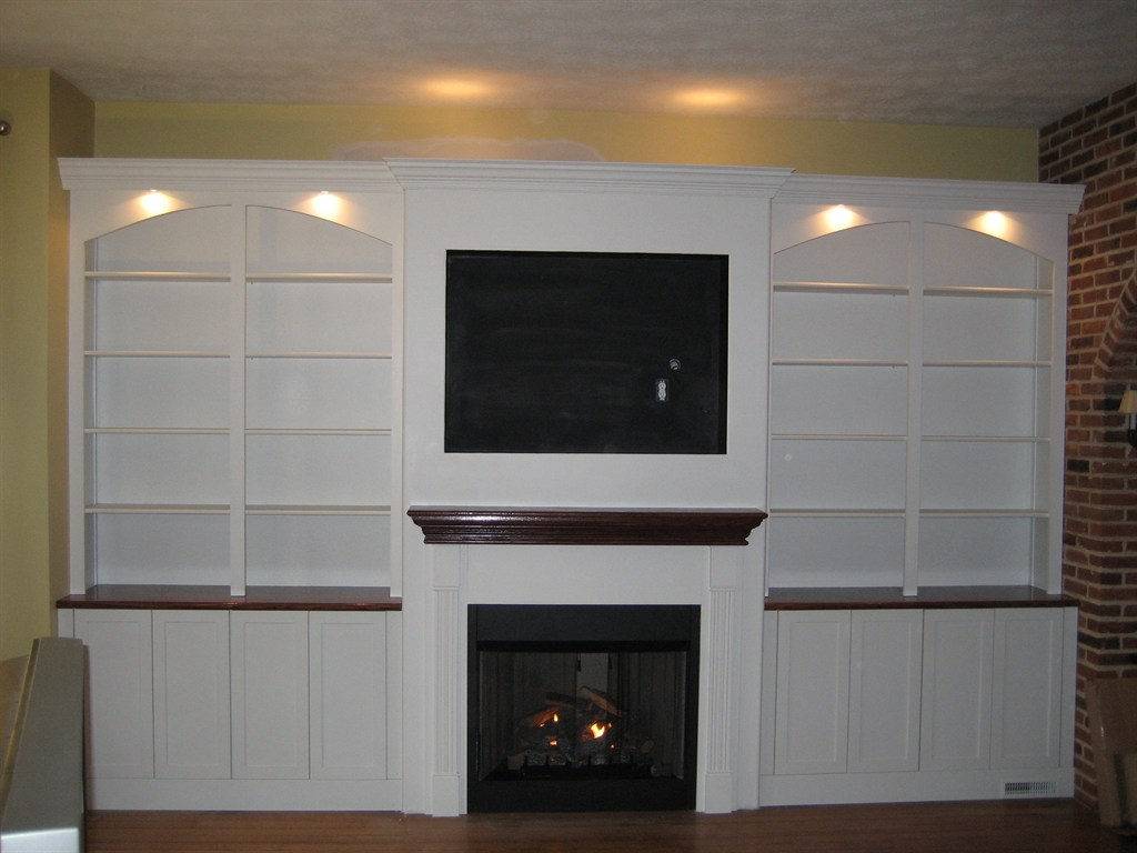 stone fireplace with built ins and tv viewing gallery