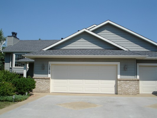 Roof, Siding, Vinyl Shakes, Aluminum Trim and Seamless Gutters