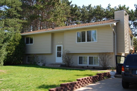 30 Year Architectural Shingle, New Vinyl Siding and Seamless Gutters