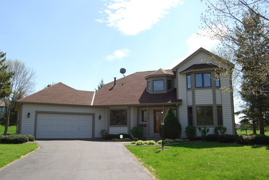 Roofing and Seamless Aluminum Gutters