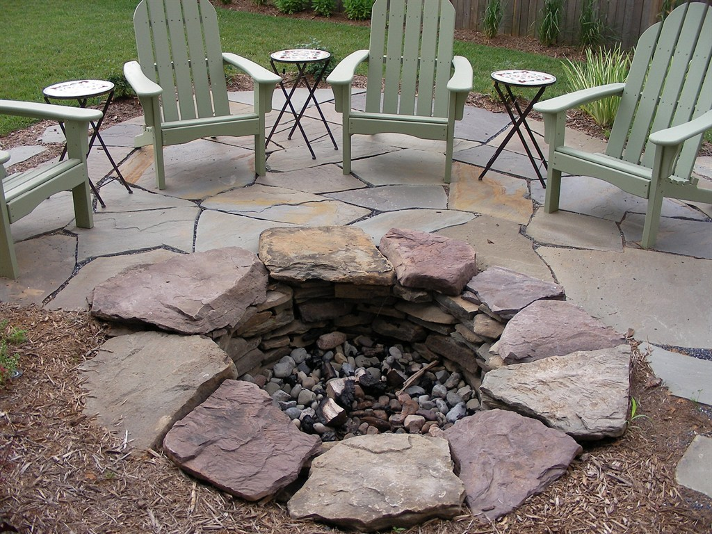 Fire pit in irregular flagstone patio