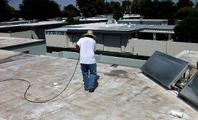$59 for a Flat Roof Pressure-Wash, Inspection,...