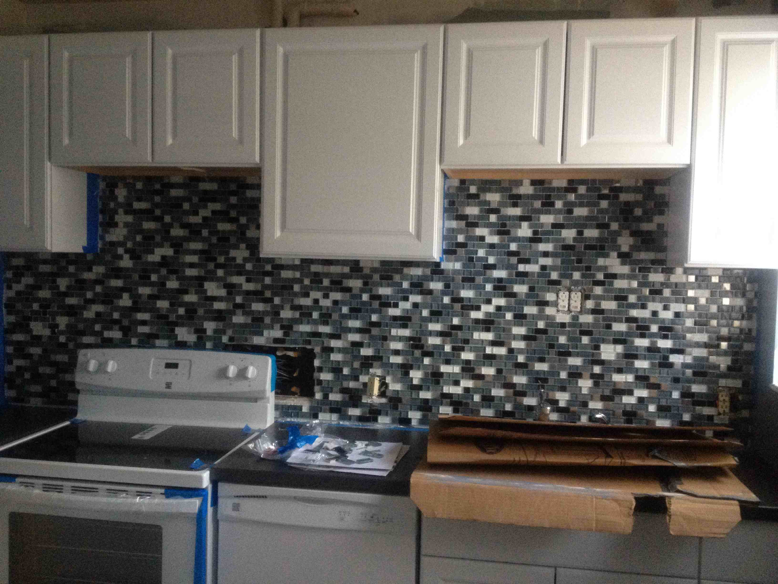 new cabinets and backsplash