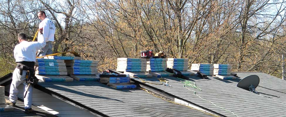 A re-roof project is underway in Oakland County Michigan