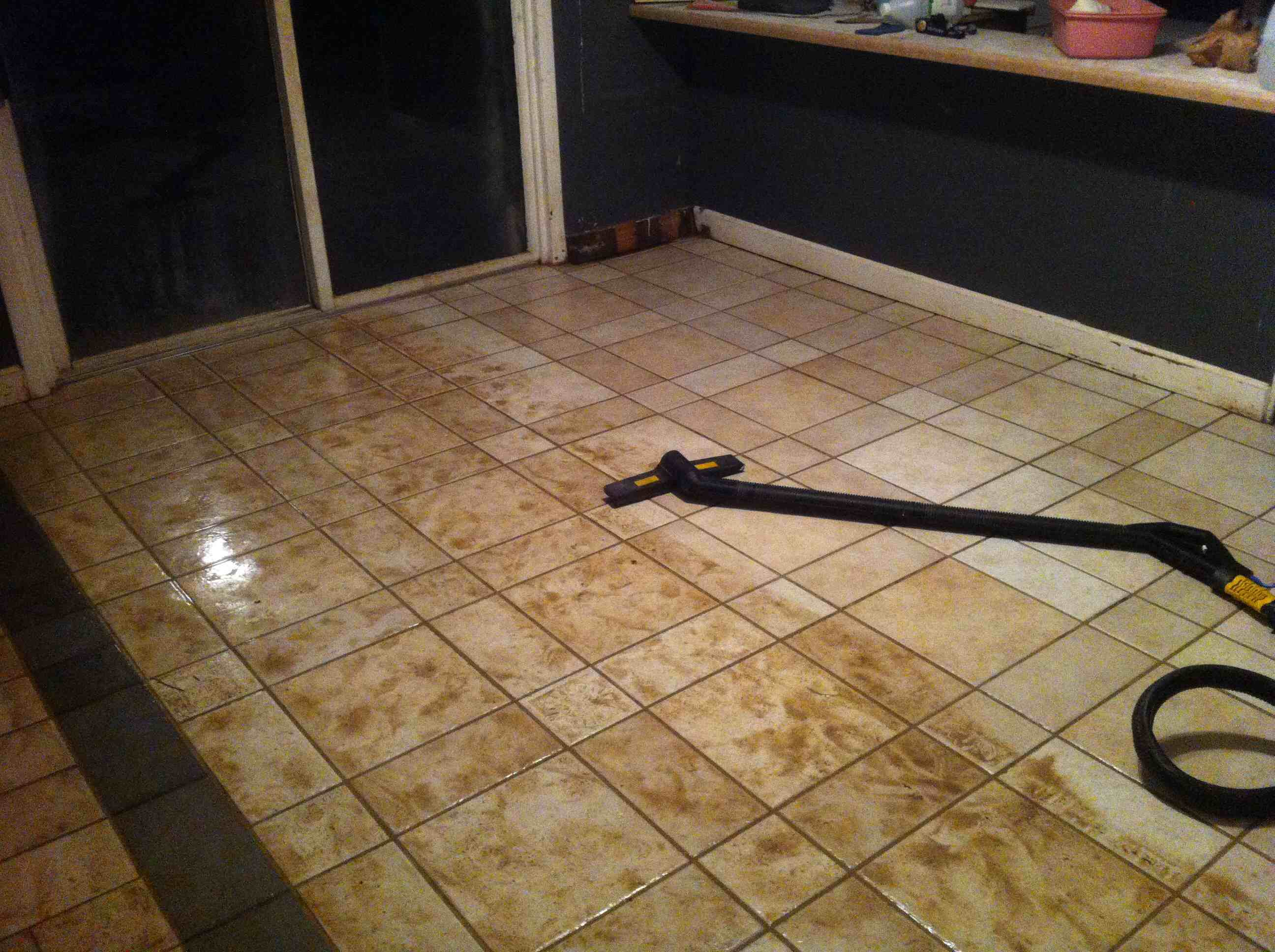 Cleaning dirty tile with superheated steam.  Wow!