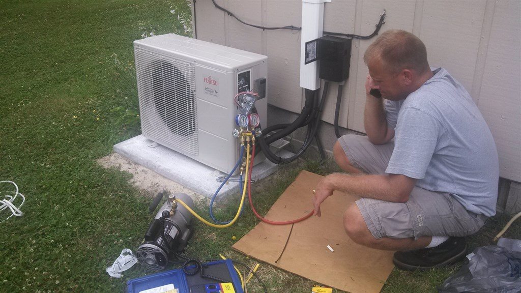Robbie, our master HVAC tech pulling vacuum on a new Fujitsu ductless mini split system
