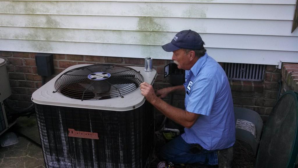 Wayne Servicing a Ducane air conditioning system