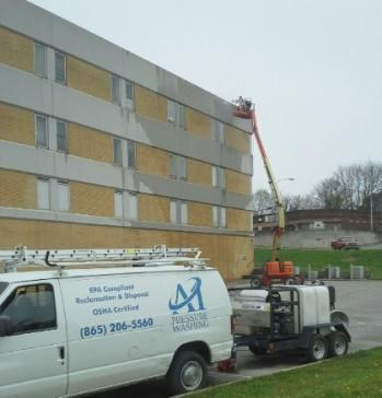 we are cleaning a concrete government building using hot water commercial pressure washing Knoxville TN