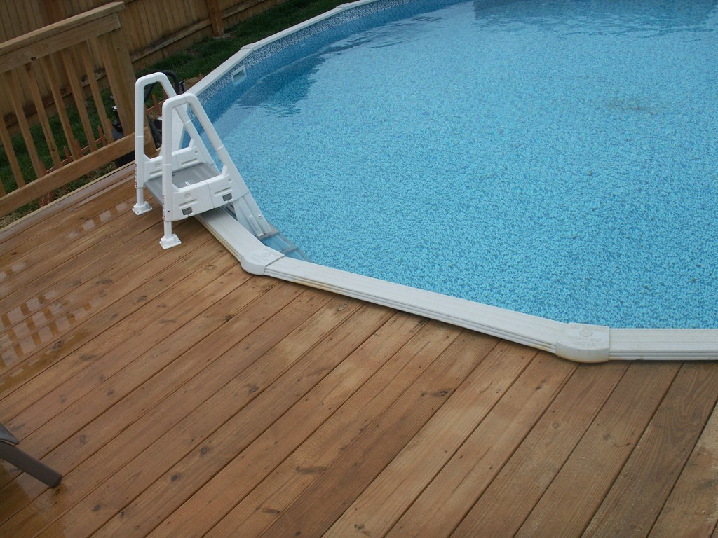 Treated Deck built around existing pool-Belton, MO