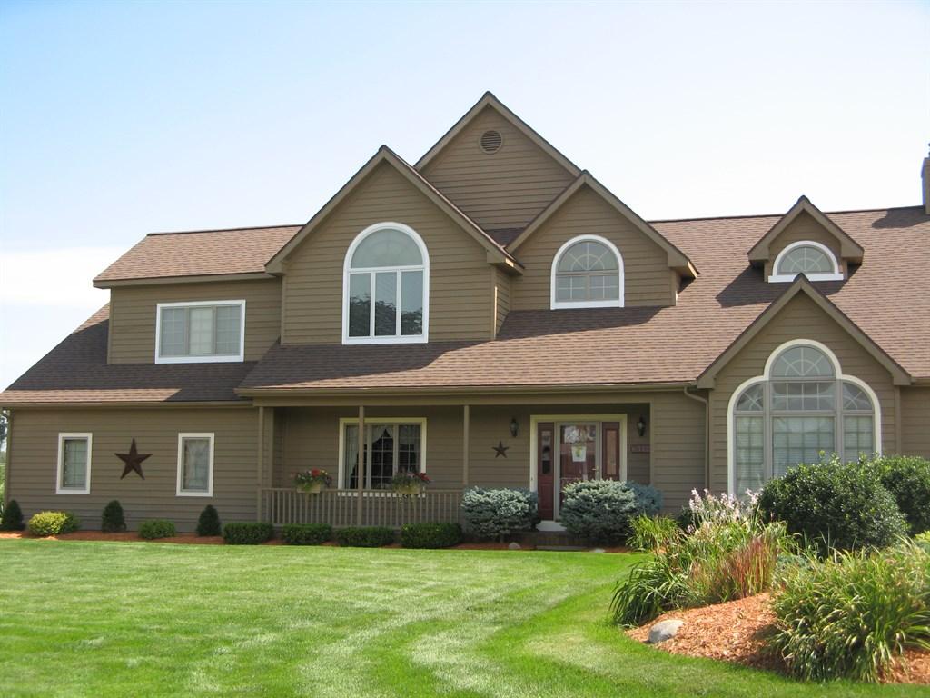 28 brown brick homes white trim panoramio photo of for Dark brown exterior trim