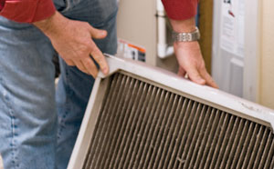 Change furnace filters regularly to keep your system working efficiently. (Photo by James Holk)