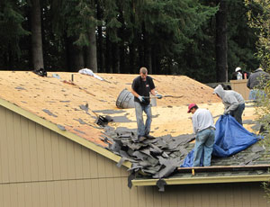 tearing off an old roof to the decking